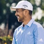 Xander Schauffele makes his bed