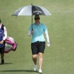brittany lincicome walks with umbrella