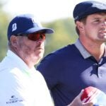 bryson dechambeau talks to his caddie