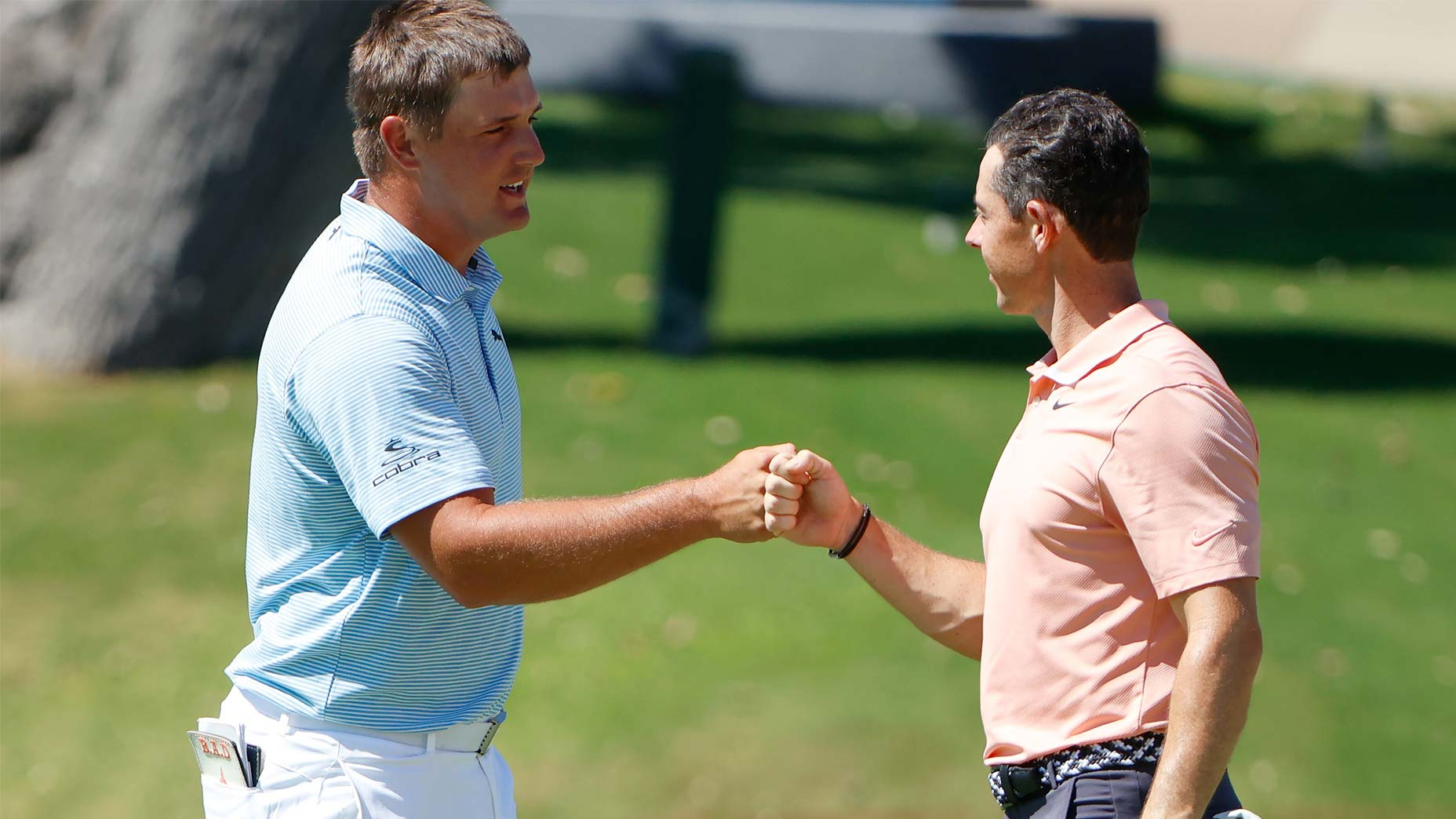 bryson dechambeau and rory mcilroy fist bump