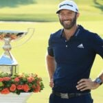 dustin johnson with trophy
