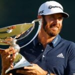 dustin johnson with fedex cup strophy