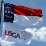 usga and north carolina flags fly
