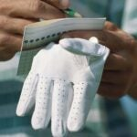 hand with scorecard