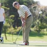 Golfers putting
