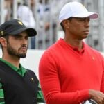 abe ancer stands with tiger woods