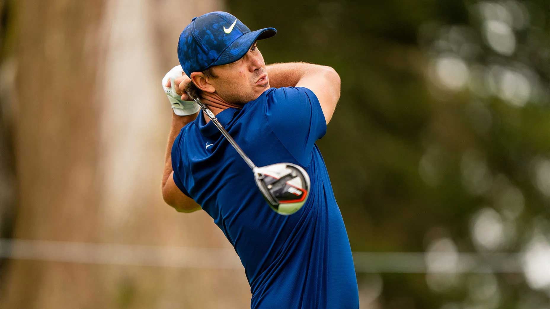 Brooks Koepka hits driver.