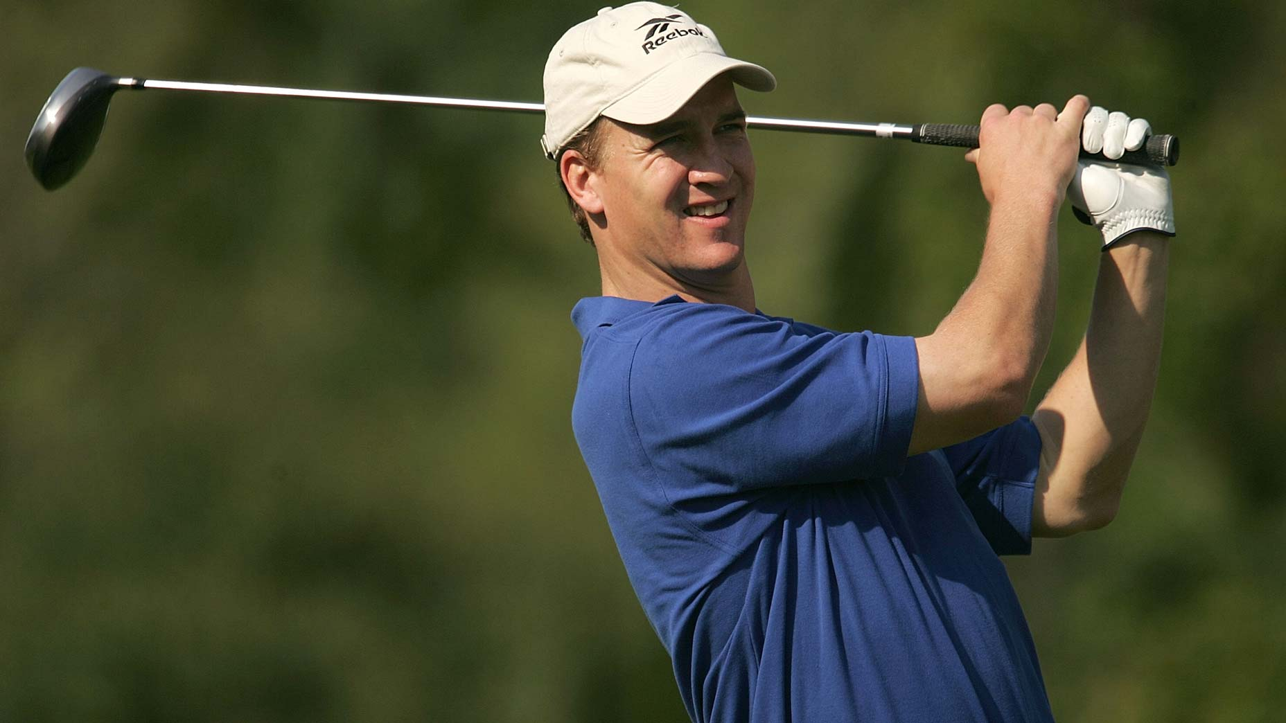 peyton manning swings