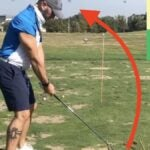 Golfer practicing anti-slice drill