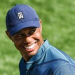 tiger woods smiles