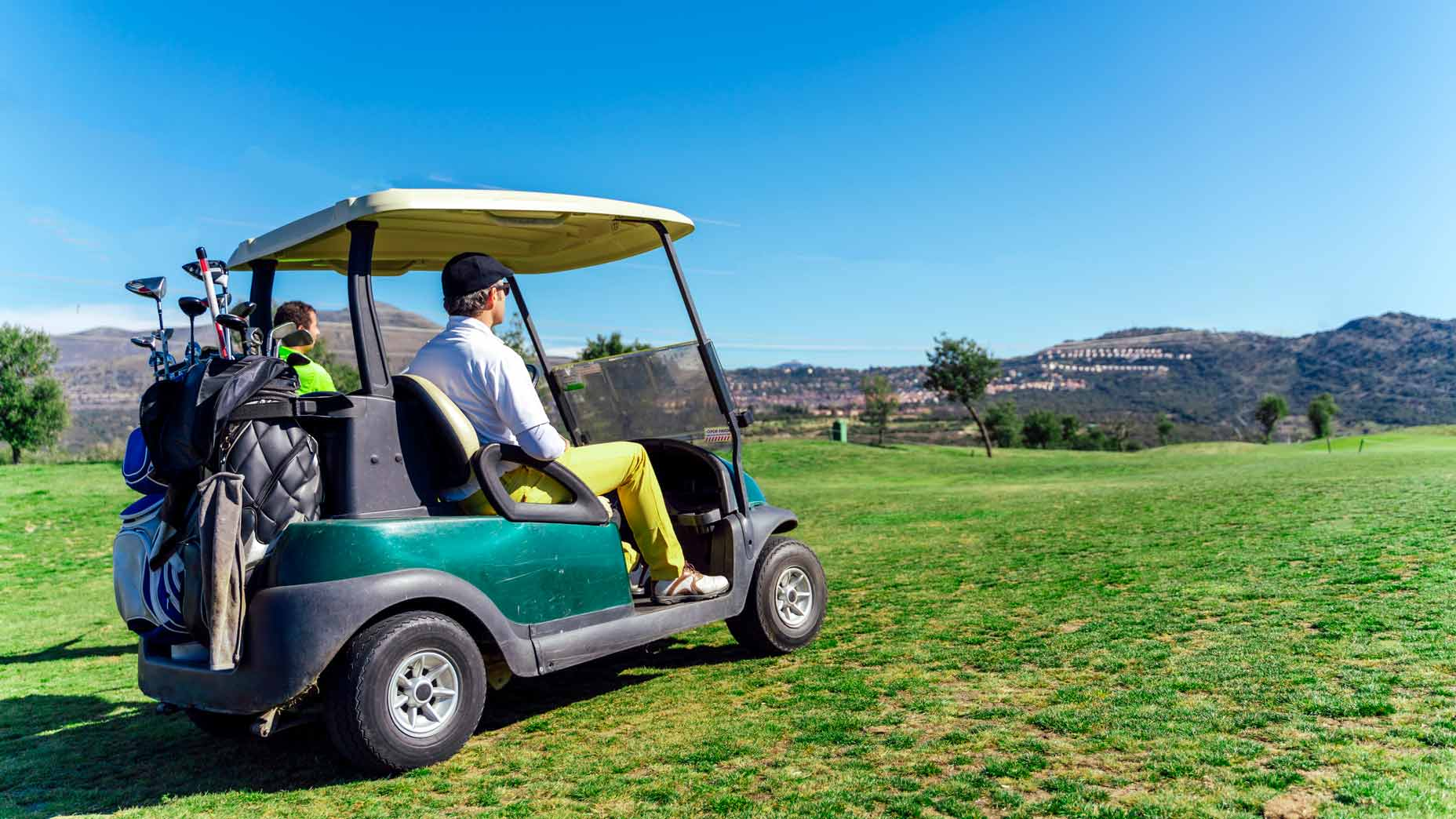 players in golf cart