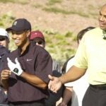 Charles Barkley and Tiger Woods play golf