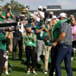 Dustin Johnson and Paulina Gretzky hug.