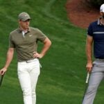 rory mcilroy stands with dustin johnson