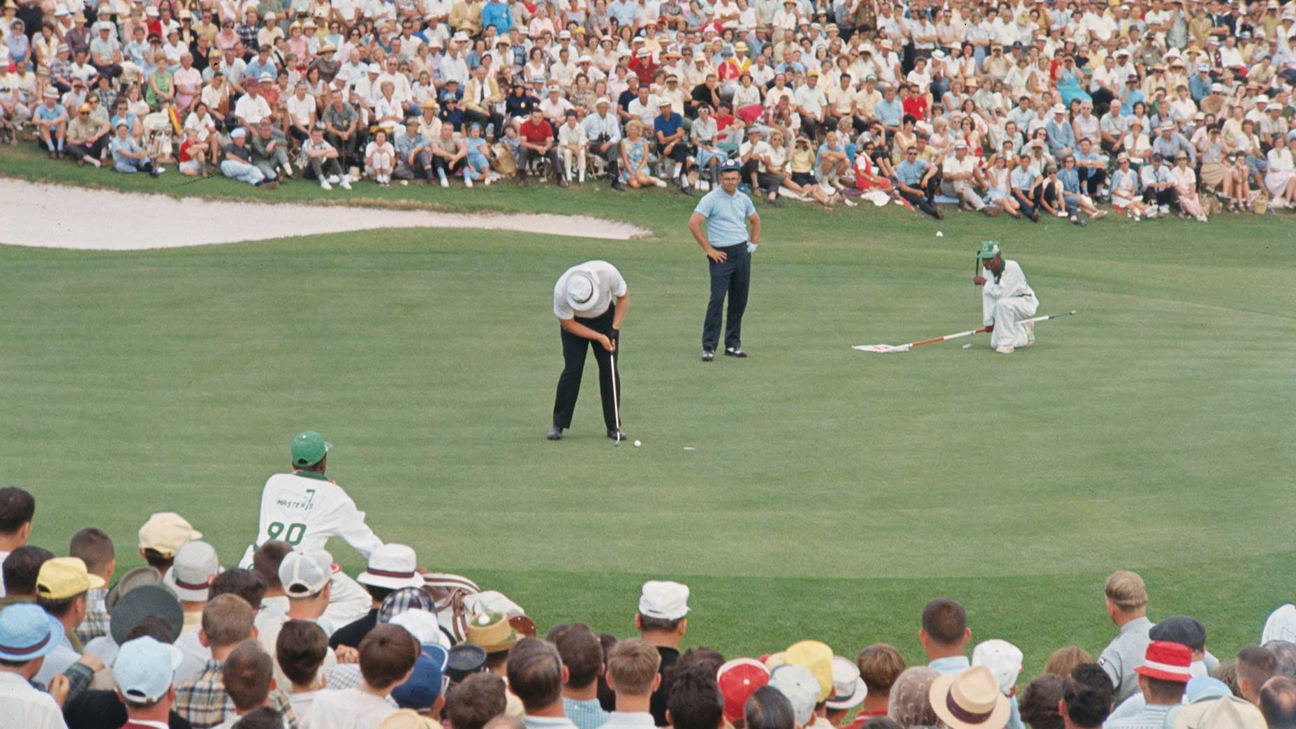 Jack Nicklaus putts at the 1965 Masters.