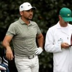 Jason Day looks over a shot at the 2020 Masters.
