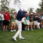 Dustin Johnson hits at the Masters.
