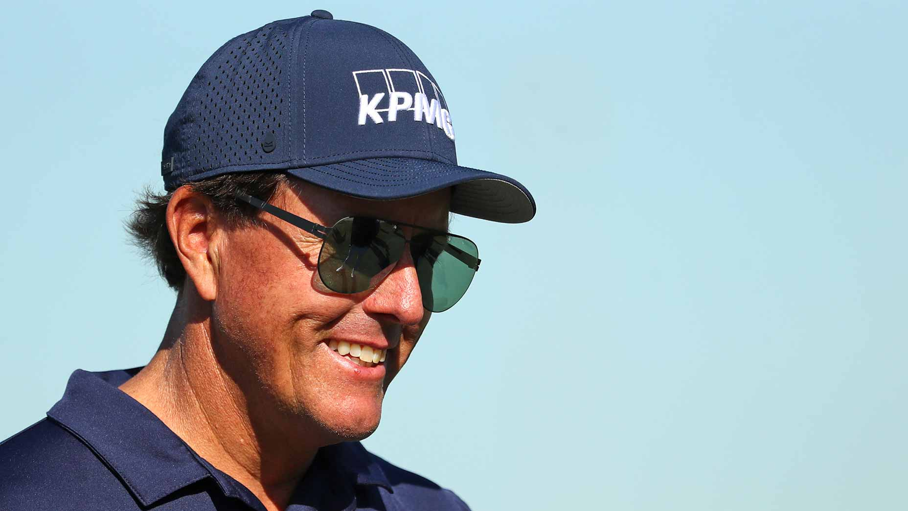 phil mickelson smiles navy hat