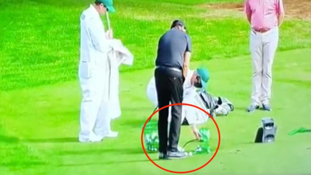 Phil Mickelson chips at the practice area at Augusta National.