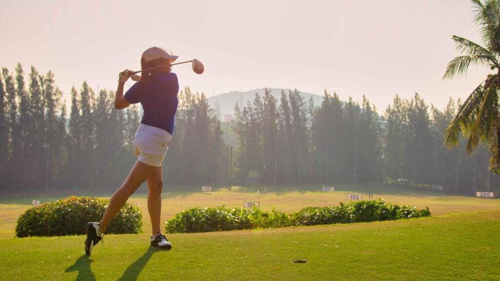 golfer hitting fairway wood