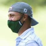 justin thomas in a protective mask