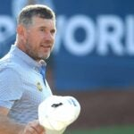 lee westwood raises hat