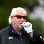 john daly smokes cigarette