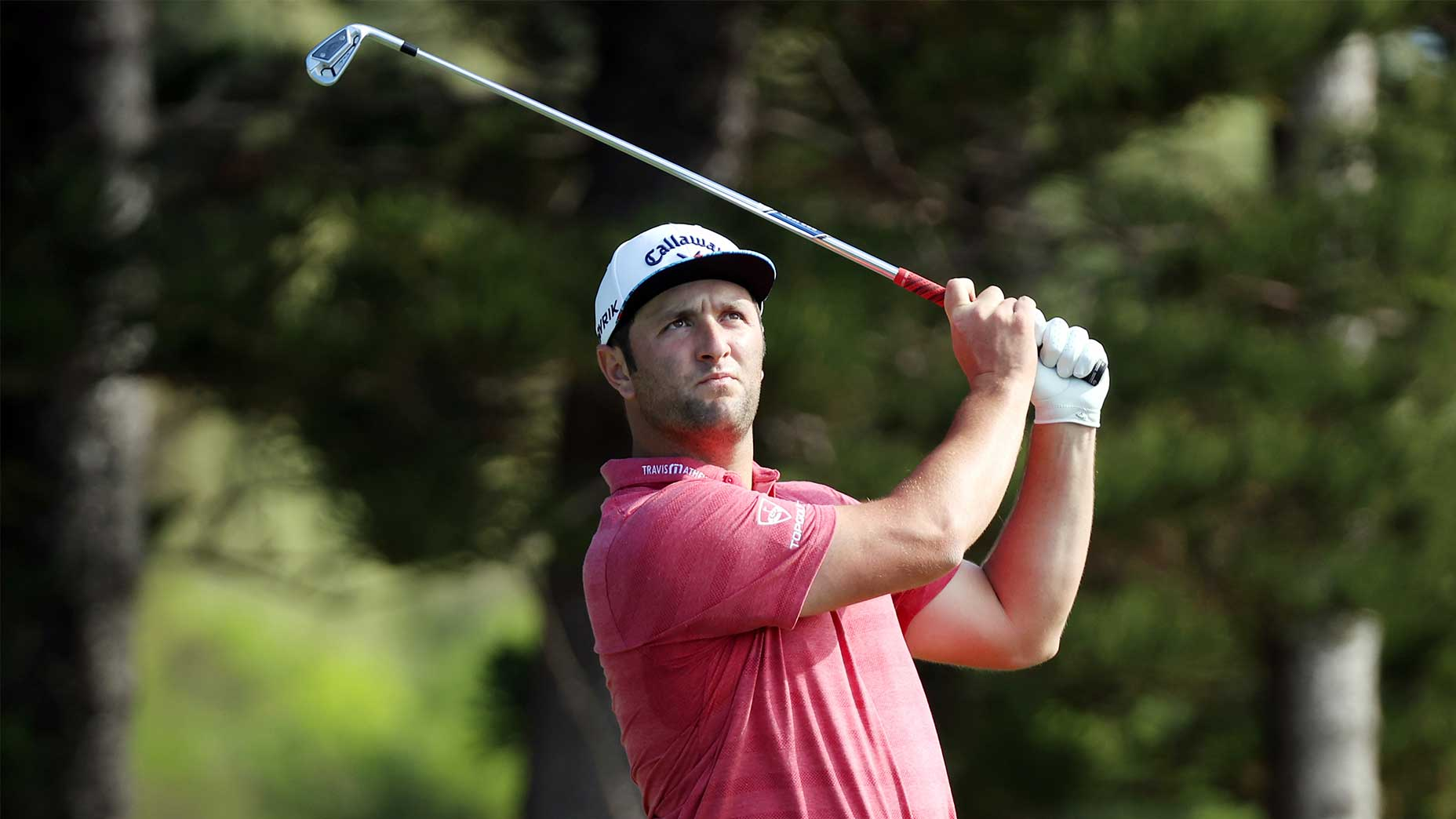 jon Rahm hits a shot at the 2021 sentry tournament of champions.
