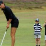 kids watch golf