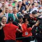 tiger woods hugs crowd