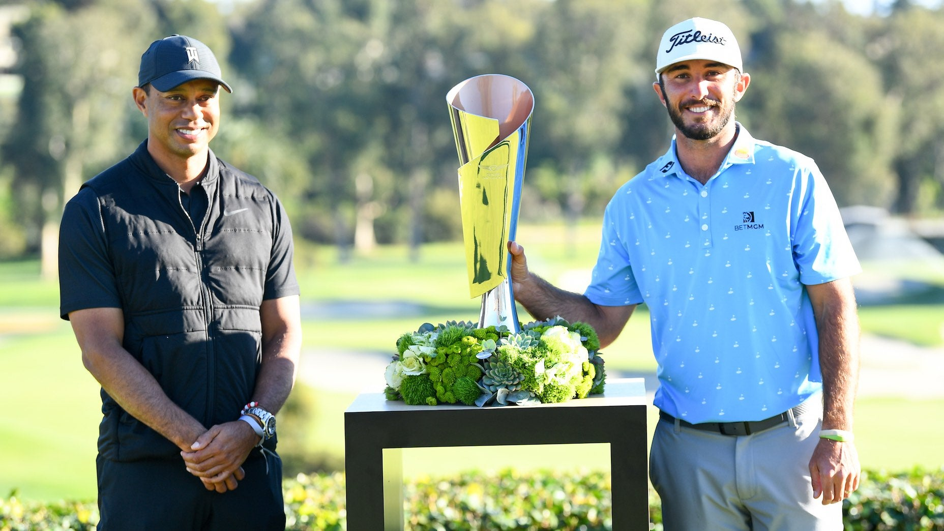 Tiger Woods presented Max Homa with the Genesis Invitational trophy on Sunday.