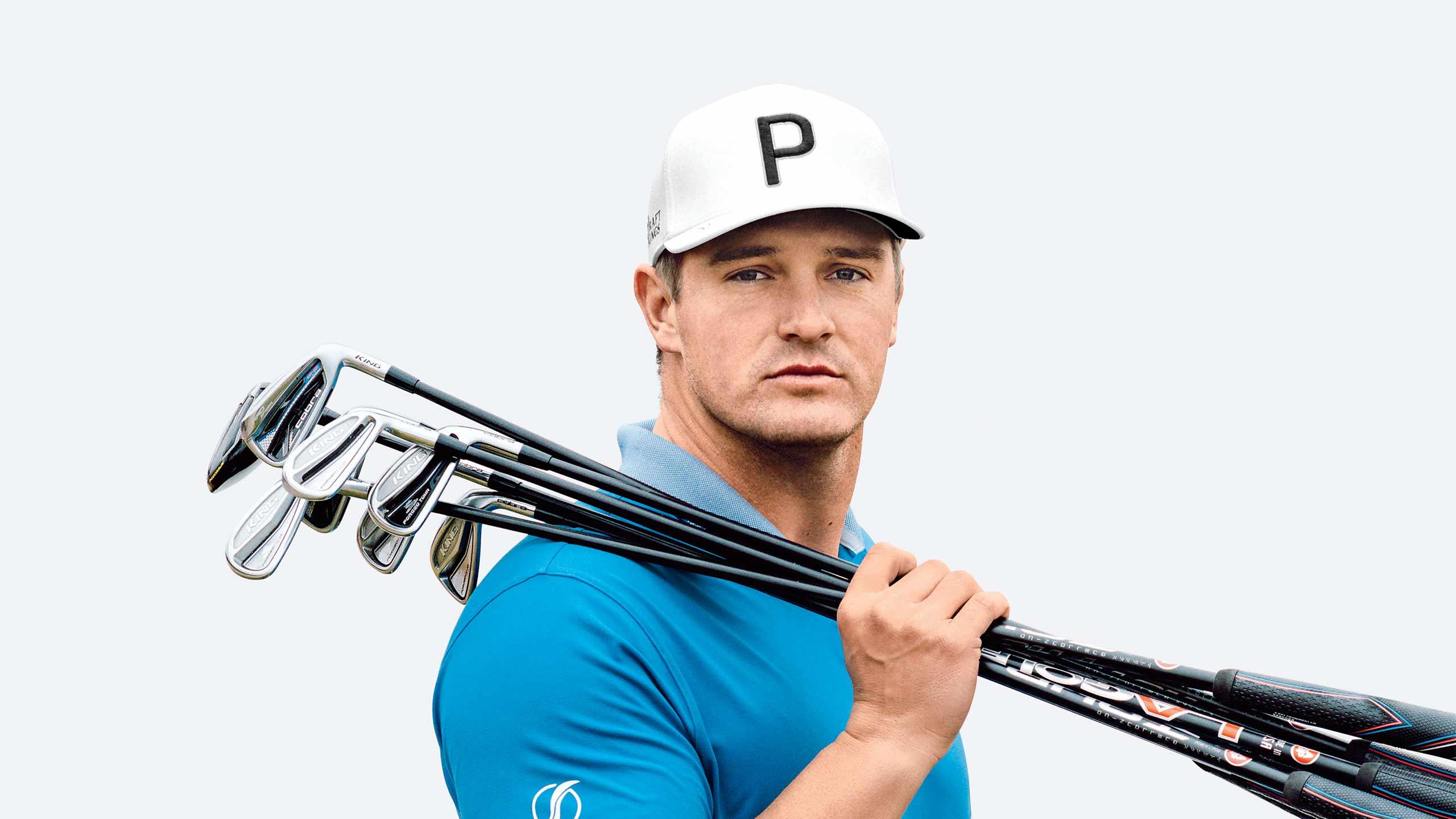 Bryson DeChambeau holds golf clubs.