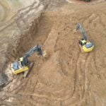 Diggers get to work on bury pits.