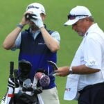 Justin Thomas uses a range finder.
