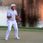 Bryson DeChambeau celebrates his victory on the 18th green at Bay Hill.