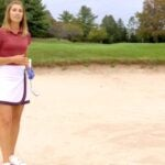 erika larkin stands in fairway bunker