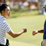 kevin na fist bumps dustin. johnson