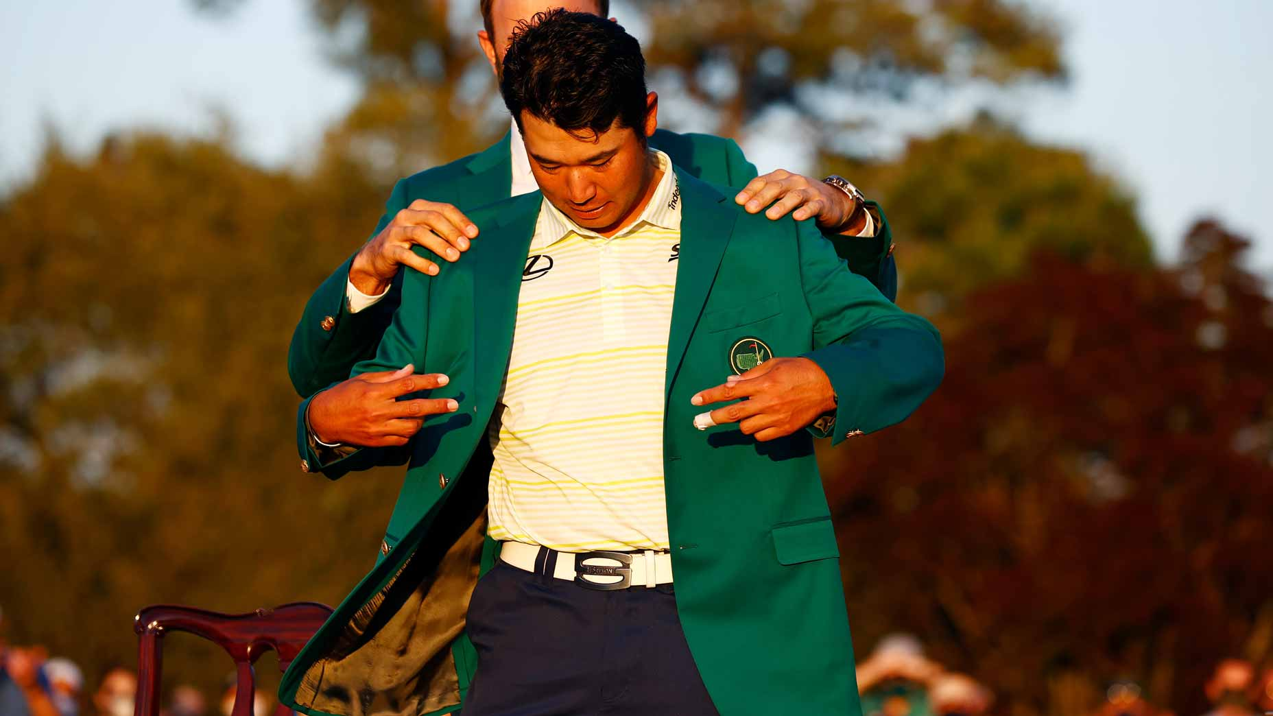 hideki matsuyama slips on the green jacket.