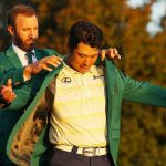 Dustin johnson puts the green jacket on hideki matsuyama