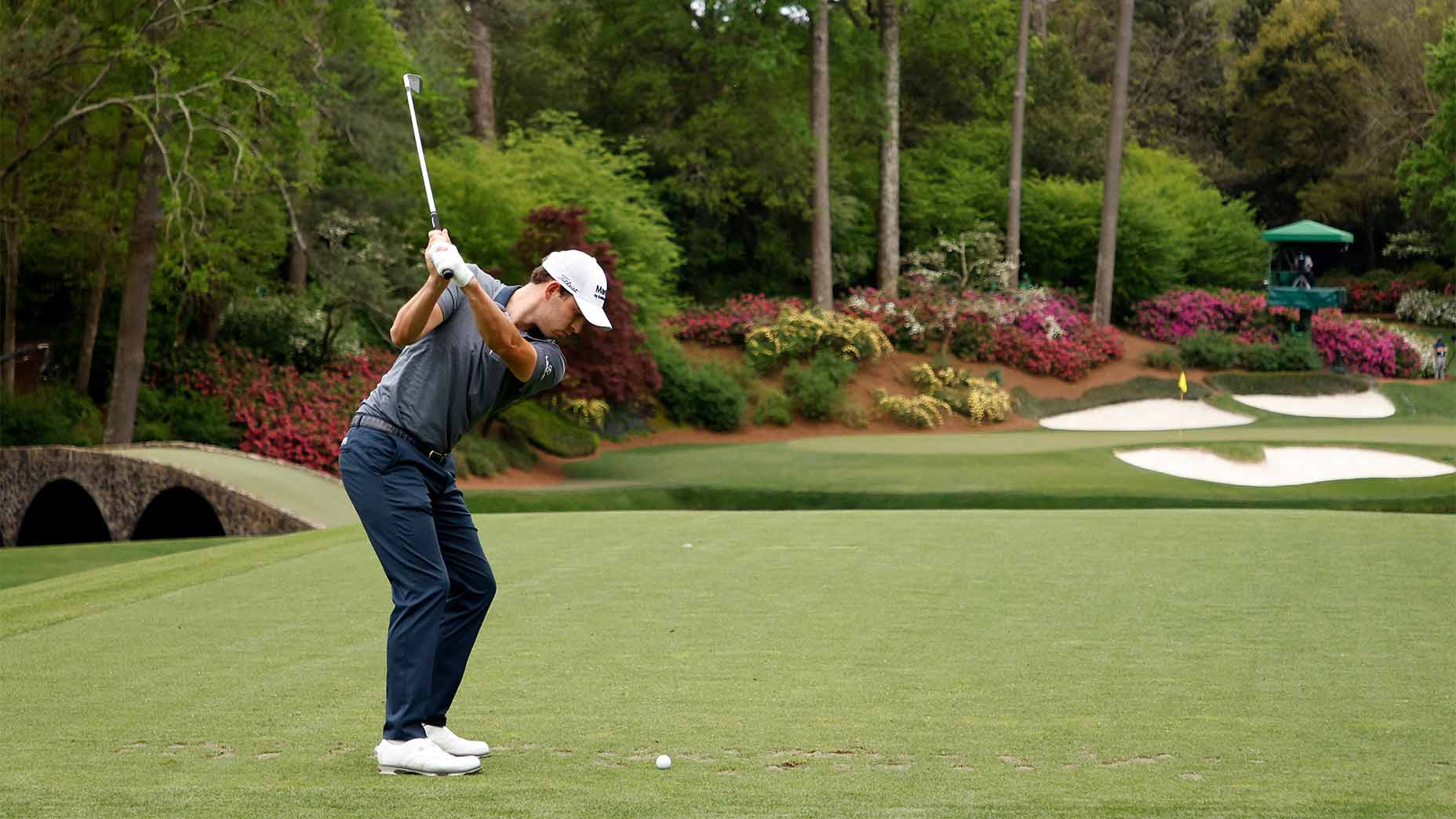 Patrick Cantlay hits his tee shot to the par-3 12th green at Augusta National on Thursday.