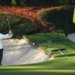 Rory McIlroy splashes out of the bunker at the 2021 Masters on Tueday.