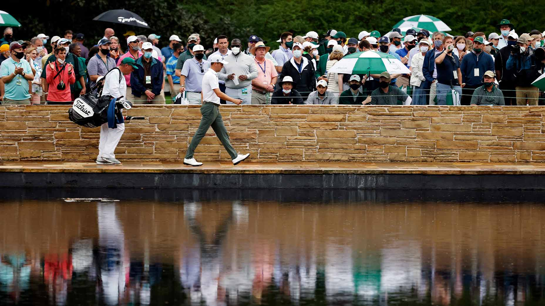 justin thomas walks rain