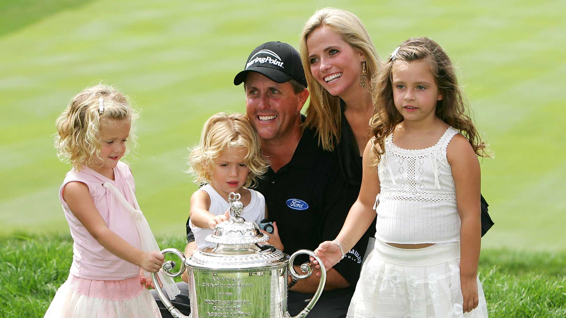 Amy and Phil Mickelson and their children, from left to right, Sophia, Evan and Amanda, after Phil's victory at the 2005 PGA Championship.