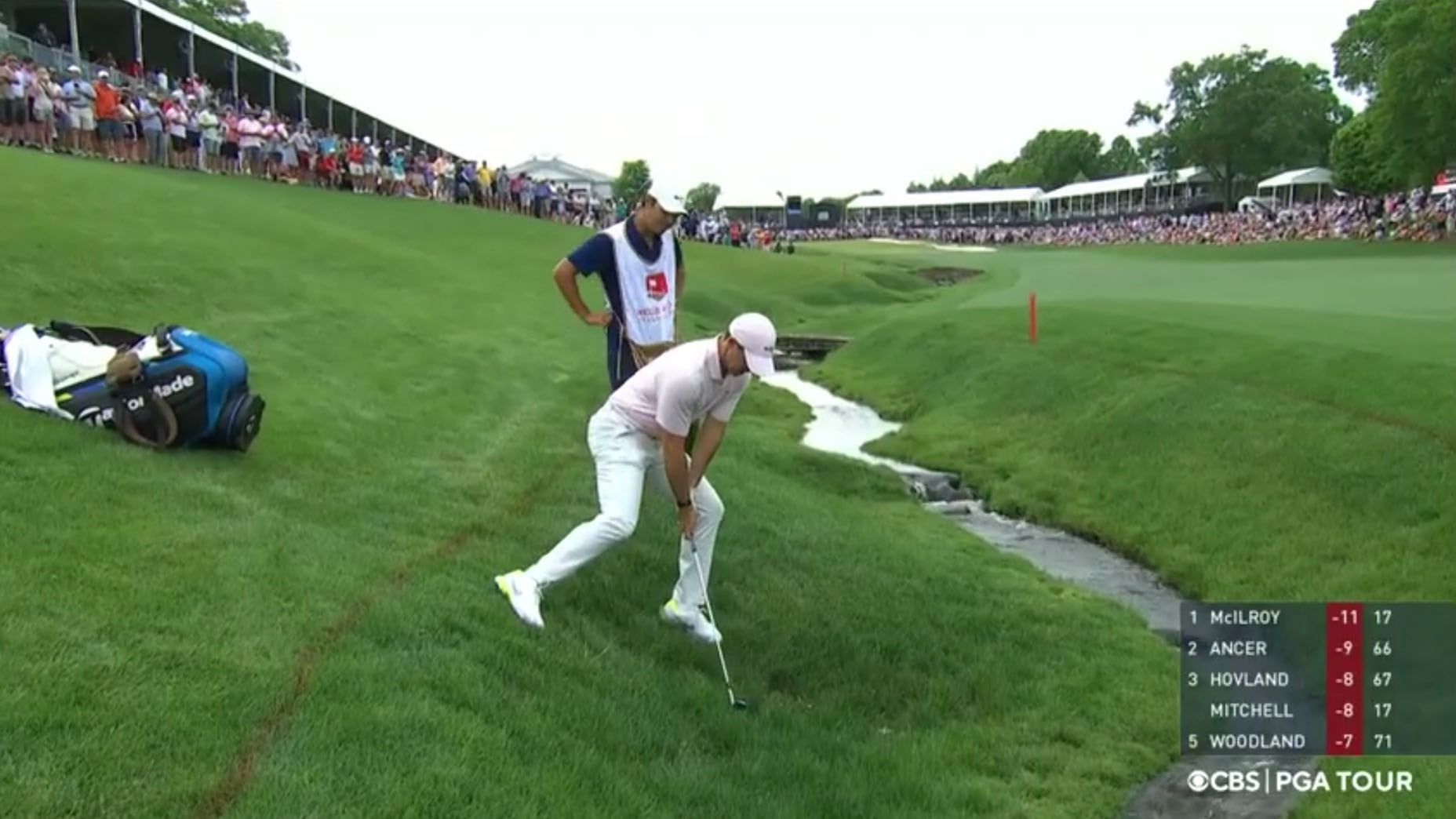 Rory McIlroy and Harry Diamond confronted a decidedly awkward lie late in Sunday's round.