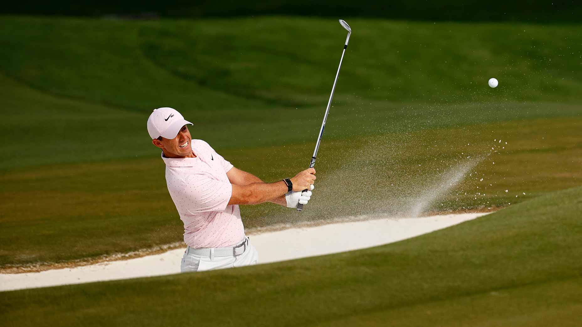 rory mcilroy hits bunker shot