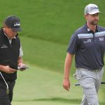 Phil Mickelson and Webb Simpson walk down the fairway