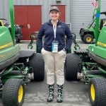 Kennedy Ellis is the youngest member of the all-female volunteer groundskeeper crew at the U.S. Women's Open.