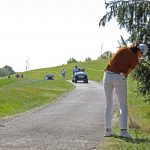 golfer standing cart path