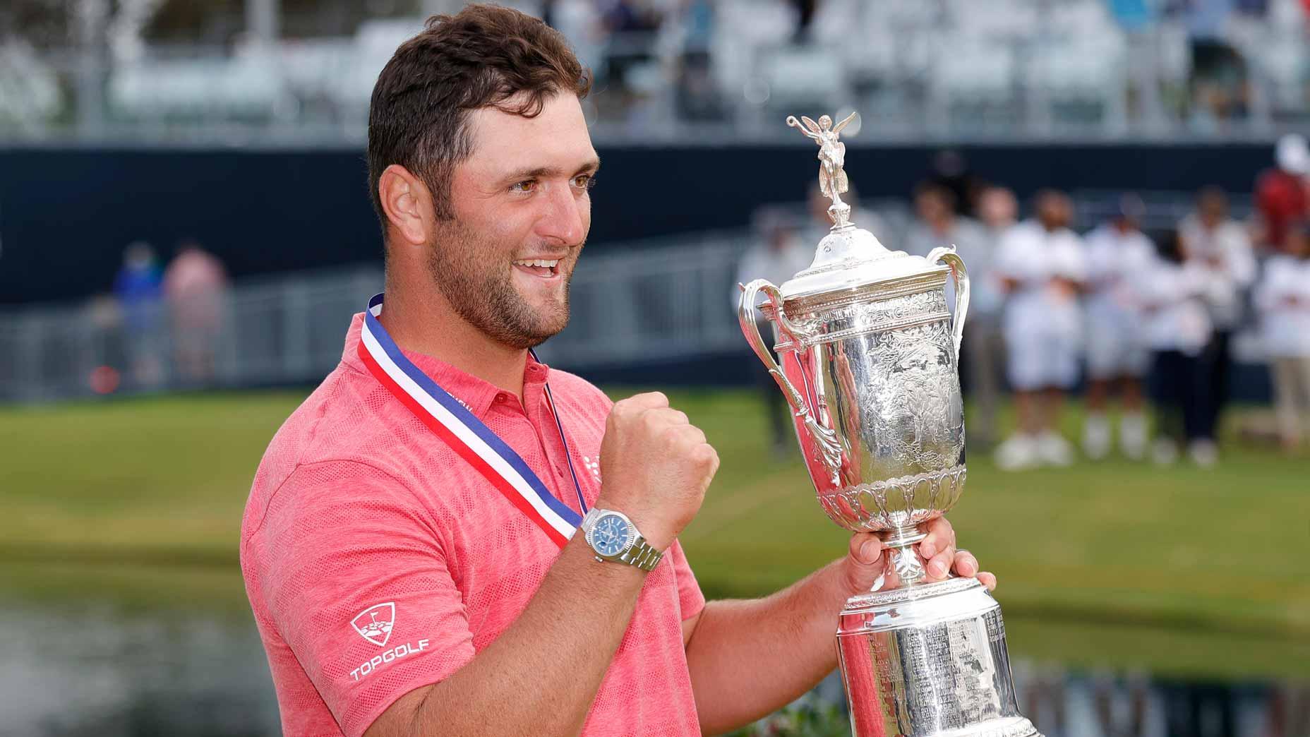 jon rahm with trophy