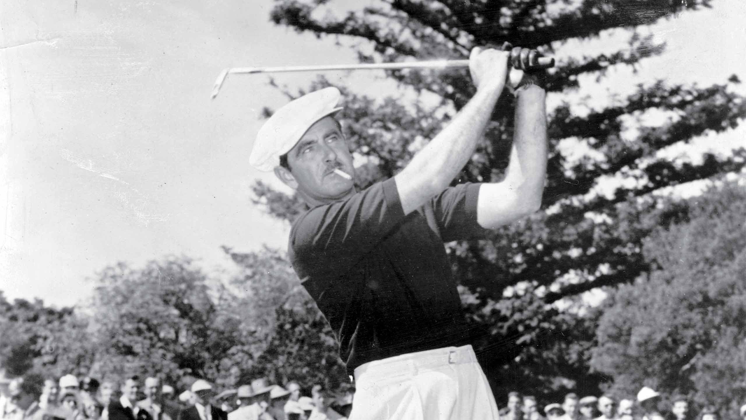Lloyd Mangrum, winner of the 1946 U.S. Open Championship, hits a shot.